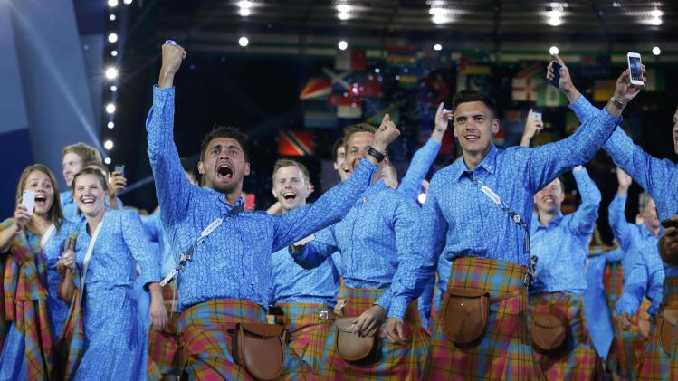 Scotland's Kenny Bain cheers as he and his teammates enter the stadium during the opening ceremony for the 2014 Commonwealth Games at Celtic Park in Glasgow