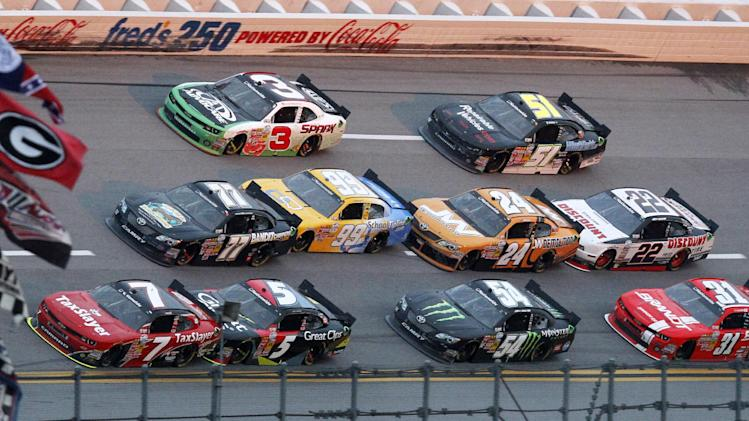 Regan Smith (7) leads a group of cars during the NASCAR Nationwide Series auto race at Talladega Superspeedway in Talladega, Ala., Saturday, May 4, 2013. Smith won the race. (AP Photo/Butch Dill)
