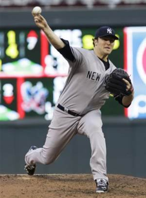 Hughes sharp in Yankees' 7-3 win over Twins