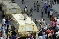 An Egyptian protester confronts an army officer following the deployment of a military unit in the Abbassiya district of Cairo, May 2. Campaigning for Egypt&#39;s first post-uprising presidential poll was temporarily on hold after thugs attacked an anti-military protest near the defence ministry in Cairo, leaving 20 people dead