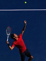 Roger Federer of Switzerland serves while practicing prior to the start of the 2012 US Open on August 26, 2012 in the Flushing neighborhood, of the Queens borough of New York City. Federer aims to cap his dramatic renaissance by becoming the first man in 87 years to win six US Open titles when the season&#39;s last Grand Slam event takes place from Monday