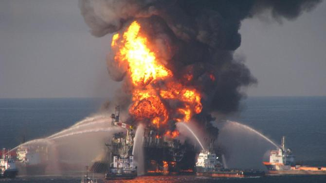 FILE - In this April 21, 2010 photo provided by the U.S. Coast Guard, fire boat response crews spray water on the burning remnants of BP's Deepwater Horizon offshore oil rig. The gargantuan legal bill for the 2010 catastrophic oil spill in the Gulf of Mexico is coming due for BP as a federal trial opens Monday, Feb. 27, 2012 to determine the company's liability for the blowout of its Macondo well. On the cusp of trial, phalanxes of lawyers, company officials and state officials spent the final hours in high-stakes settlement talks that law experts believed could still yield a deal right before the courtroom doors open Monday morning. (AP Photo/US Coast Guard, File)