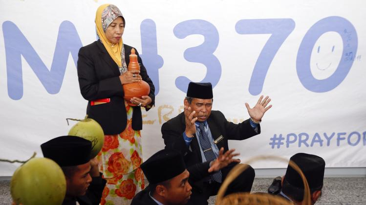 "Mat Zin, a local well-known ""bomoh"", performs a ritual to help find the missing Malaysia Airlines MH370 at Kuala Lumpur International Airport"