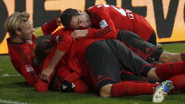 Bayer Leverkusen celebrate a goal (Reuters)