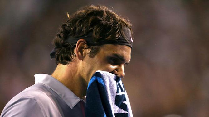 Switzerland's Roger Federer reacts during his semifinal loss to Britain's Andy Murray at the Australian Open tennis championship in Melbourne, Australia, Friday, Jan. 25, 2013. (AP Photo/Mark Kolbe,Pool)