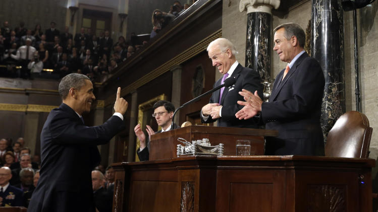 President Barack Obama gestures toward Vice President Joe Biden and House Speaker John Boehner of Ohio before giving his State of the Union address during a joint session of Congress on Capitol Hill in Washington, Tuesday Feb. 12, 2013. (AP Photo/Charles Dharapak, Pool)