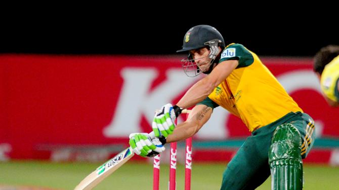In this photo taken Wednesday, March 12, 2014, South Africa's Faf du Plessis bats at the wicket during their rain-delayed T20 cricket match against Australia in Durban, South Africa. (AP Photo)