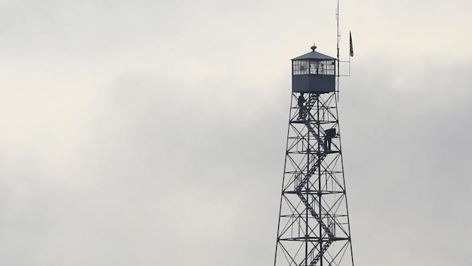 Law enforcement inspects the observation tower at the headquarters to the Malheur National Wildlife Refuge outside Burns, Oregon