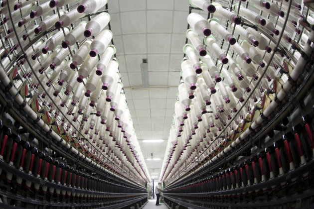 In this Wednesday, Jan. 16, 2013 photo, a woman works at a textile factory in Jiujiang city, in central China&#39;s Jiangxi province. China&#39;s economy rebounded in the final quarter of 2012 but optimism was tempered by warnings the shaky recovery could be vulnerable to a possible downturn in global trade. Economic growth rose to 7.9 percent in the three months ending in December as a recovery from China&#39;s deepest slowdown since the 2008 global crisis took hold, data showed Friday, Jan. 18, 2013. (AP Photo) CHINA OUT