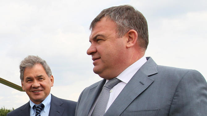 FILE - This Tuesday, June 26, 2012 file photo shows Moscow region governor Sergei Shoigu, right, and Defense Minister Anatoly Serdyukov arriving at the village of Petrovskopye, Moscow region for a meeting on the transferal of some of the military assets into civilian hands. Russian President Vladimir Putin has fired the country's defense minister two weeks after a criminal probe was opened into alleged fraud in the sell-off of military assets. Putin made the announcement of Anatoly Serdyukov's dismissal on Tuesday Nov. 6, 2012 in a meeting with Moscow regional governor Sergei Shoigu, whom he appointed as the new minister. (AP Photo/RIA Novosti, Yekaterina Shtukina, Government Press service)