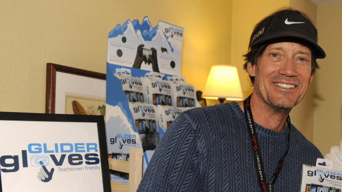 Actor Kevin Sorbo hold Glider gloves at the Fender Music lodge during the Sundance Film Festival on Saturday, Jan. 19, 2013, in Park City, Utah. (Photo by Jack Dempsey/Invision for Fender/AP Images)