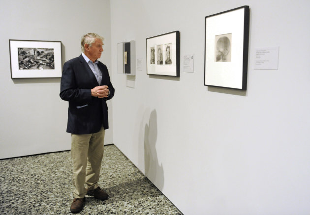 In this Thursday, Nov. 8, 2012 photo, photographer Don McCullin views some of the works in the Houston Museum of Fine Arts&#39; war photography exhibit in Houston. The exhibit includes the work of 280 photographers from 28 nations covering the Mexican-American war in 1846 to present-day. McCullin has four photos in the exhibit. (AP Photo/Pat Sullivan)