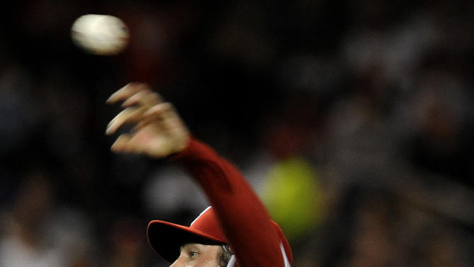 Philadelphia Phillies' starting pitcher Cole Hamels delivers pitch to a Washington Nationals' batter in the sixth inning during their baseball game at Nationals Park, Sunday, May 6, 2012, in Washington. Phillies defeated the Nationals 9-3. (AP Photo/Richard Lipski)