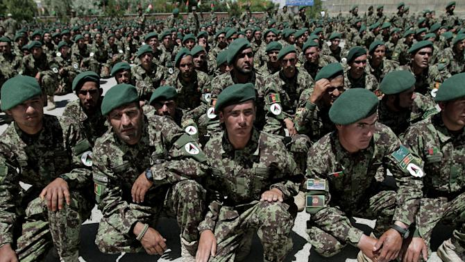 In this Saturday, June 15, 2013 photo, Afghan National Army solider's, attend their graduation ceremony in Kabul, Afghanistan. One of the most significant turning points in one of America's longest and costliest wars is imminent: Afghanistan's fledgling security forces are taking the lead for security nationwide, bringing the moment of truth on the question of whether they are ready to fight an insurgency that remains resilient after nearly 12 years of conflict. That question is especially pressing here in this border region where insurgents regularly ambush government forces and control parts of the countryside. (AP Photo/Rahmat Gul)