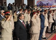 A picture from the Egyptian presidency shows President Mohamed Morsi (2nd left) with military council chief Field Marshal Hussein Tantawi (left) at a ceremony in Cairo. Morsi has ordered the return of the dissolved parliament, in a challenge to the powerful military that had enforced a court decision to disband the Islamist-led legislature
