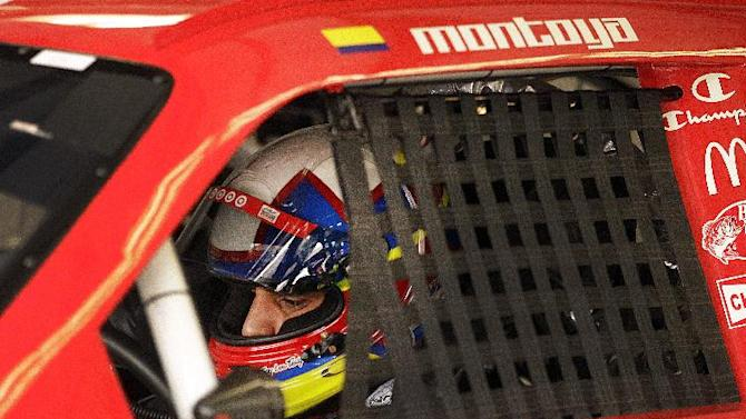 Juan Pablo Montoya, of Colombia, prepares for practice for Sunday's NASCAR Sprint Cup Series auto race, Friday, June 22, 2012, in Sonoma, Calif. (AP Photo/Ben Margot)