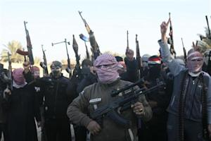 Masked Sunni gunmen chant slogans during a protest against Iraq's Shiite-led government, demanding that the Iraqi army not try to enter the city, in Falluja