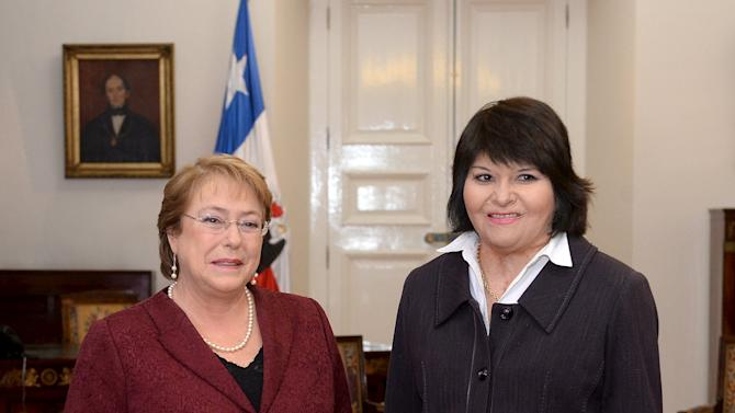 Chile's President Bachelet and Quintana, who suffered serious injuries when she was set on fire during a Santiago labor strike on July 2, 1986, meet at the government palace in Santiago, Chile