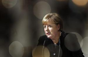 German Chancellor Angela Merkel delivers a speech during a gala dinner of the BDA in Berlin