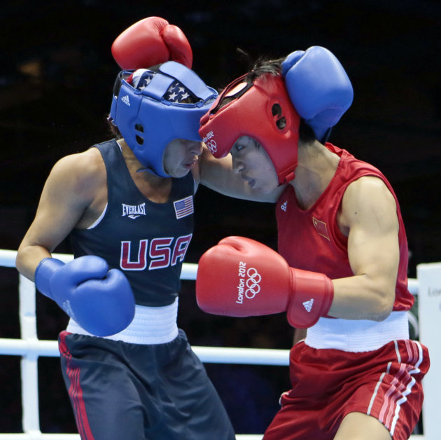 China's Ren Cancan, right, fights Marlen Esparza, of the United States during their women's semifinal flyweight 51-kg boxing match at the 2012 Summer Olympics, Wednesday, Aug. 8, 2012, in London. (AP