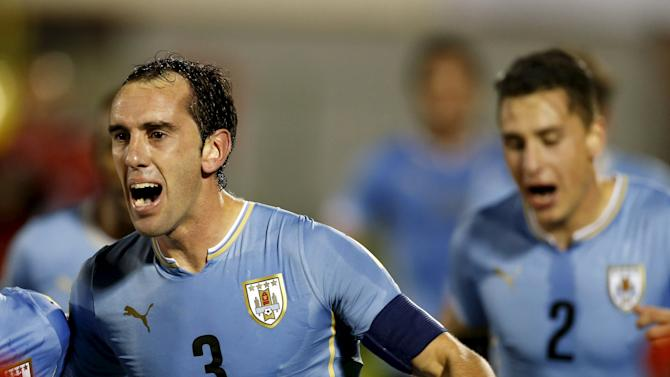Uruguay's Diego Godin and Jose Maria Gimenez celebrate Godin's goal during their 2018 World Cup qualifying soccer match against Colombia at the Centenario stadium in Montevideo