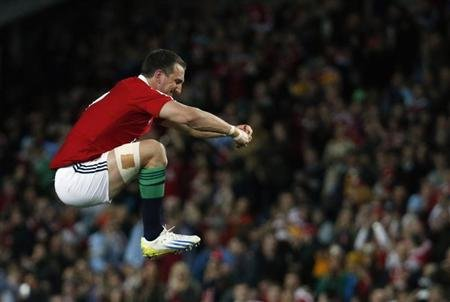 British and Irish Lions' Warburton jumps in air before start of rugby union game against New South Wales Waratahs in Sydney