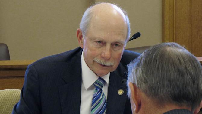 Kansas state Sen. Les Donovan, a Wichita Republican, makes a point during negotiations between the Senate and House over tax cuts, Thursday, April 26, 2012, at the Statehouse in Topeka, Kan. Donovan, the Senate's top negotiator, talks to lead House negotiator Richard Carlson, a St. Marys Republican. (AP Photo/John Hanna)