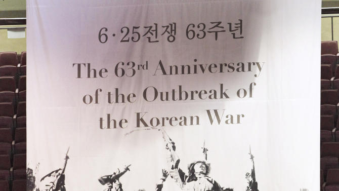 South Korean elementary school students participate in a ceremony to mark the 63rd anniversary of the outbreak of the Korean War in Seoul, South Korea, Tuesday, June 25, 2013. The three-year Korean War broke out on June 25, 1950, when Soviet tank-led North Koreans invaded South Korea. (AP Photo/Ahn Young-joon)