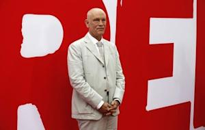 """Cast member Malkovich poses at the premiere of the film """"Red 2"""" in Los Angeles"""