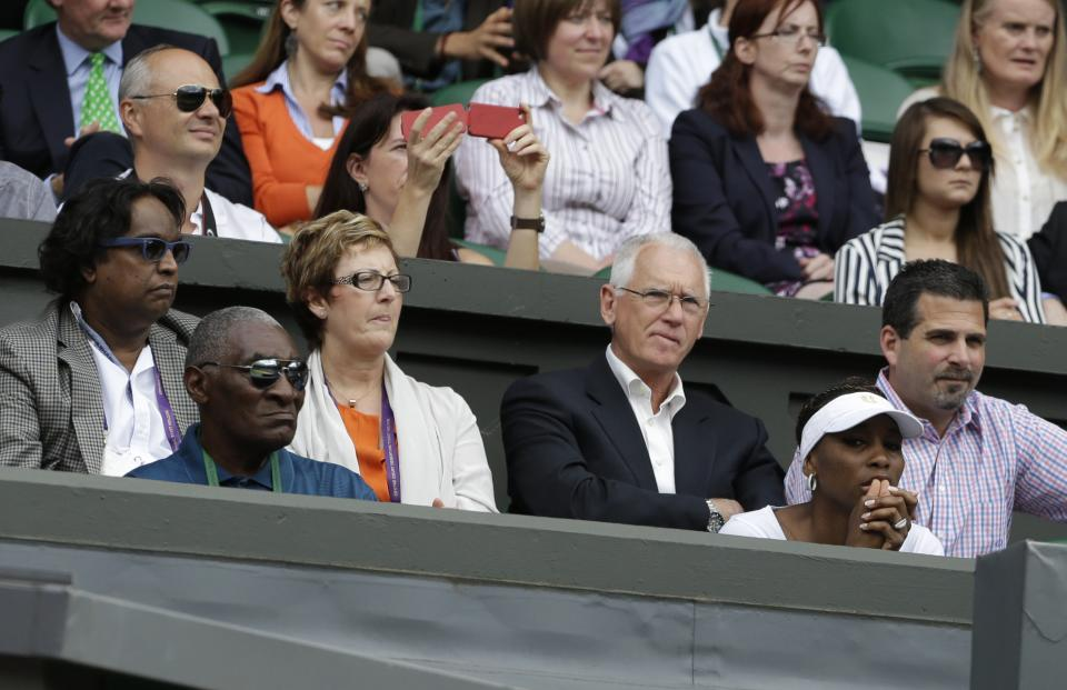 Venus Williams, front right, and her father Richard Williams, front left, watch Serena Williams of the United States face Victoria Azarenka of Belarus during a semifinals match at the All England Lawn Tennis Championships at Wimbledon, England, Thursday, July 5, 2012. (AP Photo/Anja Niedringhaus)
