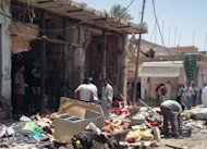 Iraqis inspect the damage following a car bombing in Zubaidiyah. A car bomb blamed on Al-Qaeda at a market in central Iraq has killed eight people and three others were murdered in Baghdad, the latest in a spike in unrest ahead of Shiite rituals