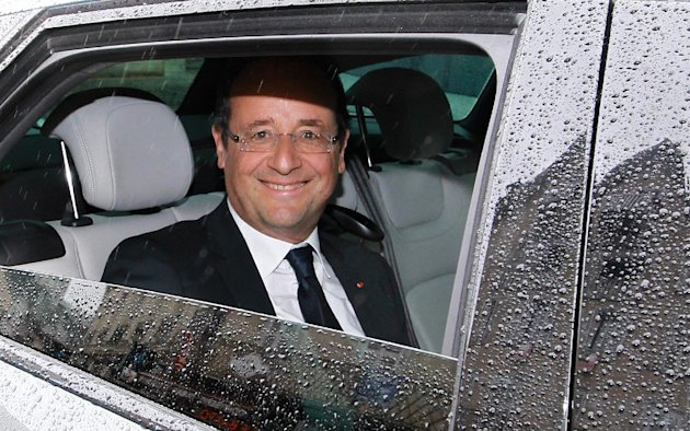 French President Francois Hollande reacts after leaving a restaurant in Tulle, central France, Sunday, June 10, 2012. (AP Photo/Bob Edme)