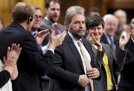 NDP leader Mulcair receives a standing ovation from his caucus in the House of Commons in Ottawa