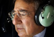 US Secretary of Defense Leon Panetta looks out the window of a Blackhawk helicopter as he flys over Baghdad. American forces are pursuing Iran-backed insurgents in Iraq, Panetta said in Baghdad on Monday as US deaths spike nearly a year after US troops formally ended combat operations