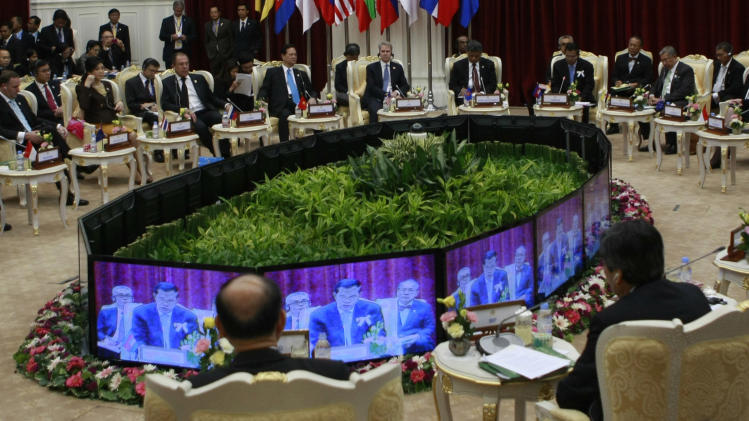 Delegates listen and watch as Cambodian Prime Minister Hun Sen, shown on the monitor screens, delivers an opening speech during the ASEAN Global Dialogue in Phnom Penh, Cambodia Tuesday, Nov. 20, 2012. (AP Photo/Apichart Weerawong)