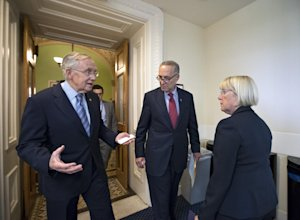 From left, Senate Majority Leader Harry Reid, D-Nev., …