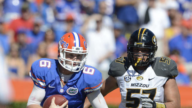 Florida quarterback Jeff Driskel (6) carries the ball against Missouri during the first half of an NCAA college football game, Saturday, Nov. 3, 2012, in Gainesville, Fla. (AP Photo/Phil Sandlin)