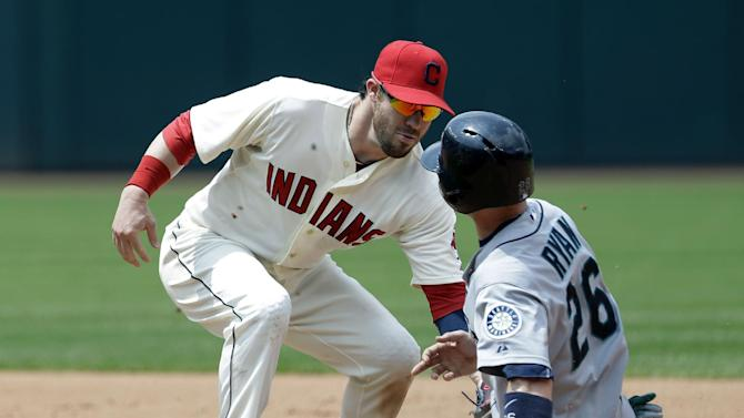 Cleveland Indians' Jason Kipnis, left, tags out Seattle Mariners' Brendan Ryan after Ryan tried to steal to second base in the seventh inning of a baseball game, Monday, May 20, 2013, in Cleveland. (AP Photo/Tony Dejak)
