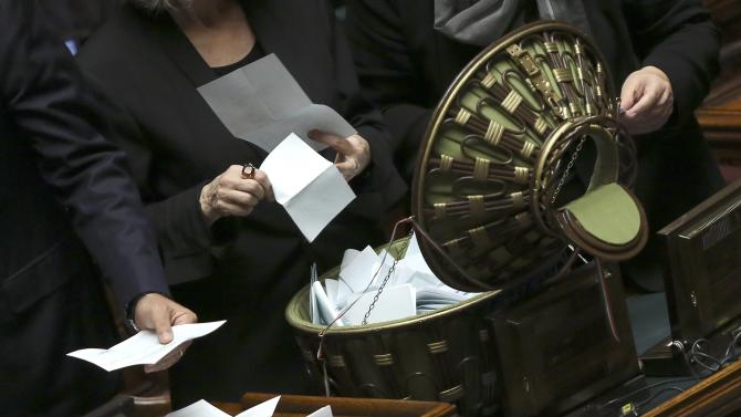 Assistant opens a ballot box at the end of the vote session at the Chambers of Deputies in Rome
