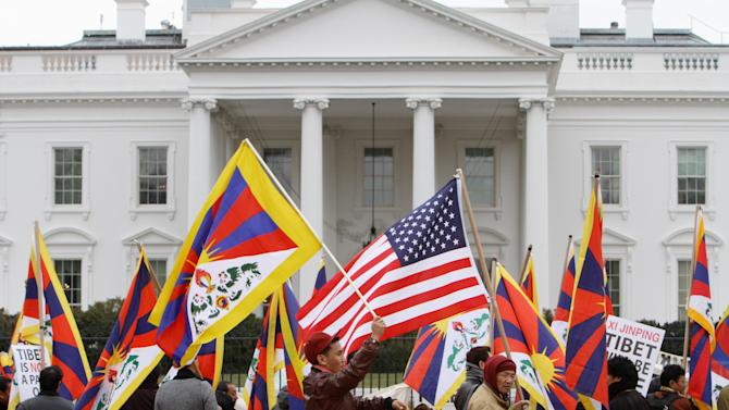 Tibetans rally outside the White House in Washington, Tuesday, Feb. 14, 2012, prior to the visit of Chinese Vice President Xi Jinping. (AP Photo/Jacquelyn Martin)