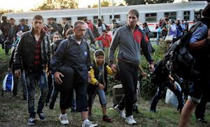 Refugees and migrants disembark from a Croatian train…