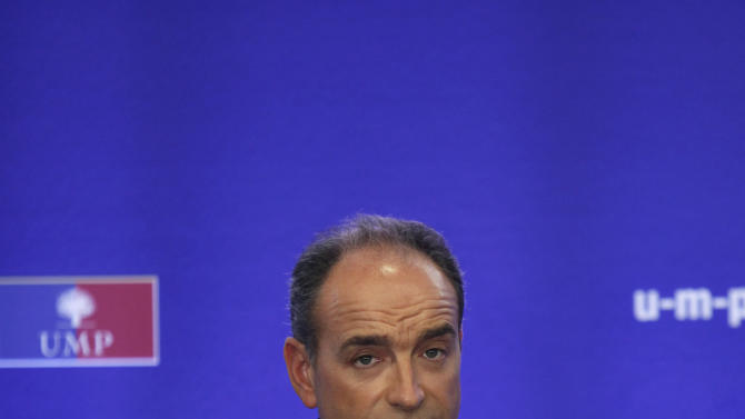 Newly elected president of UMP (Union for a Popular Movement) Jean-Francois Cope gestures as he gives a press conference, at the UMP headquarters, in Paris, Monday, Nov. 26, 2012. (AP Photo/Thibault Camus)