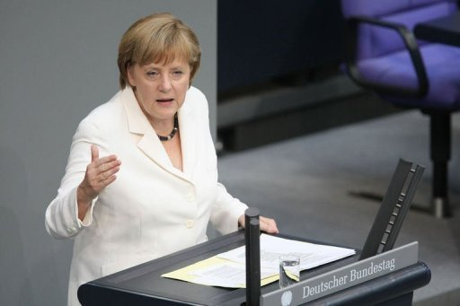 German Chancellor Angela Merkel addresses German lawmakers