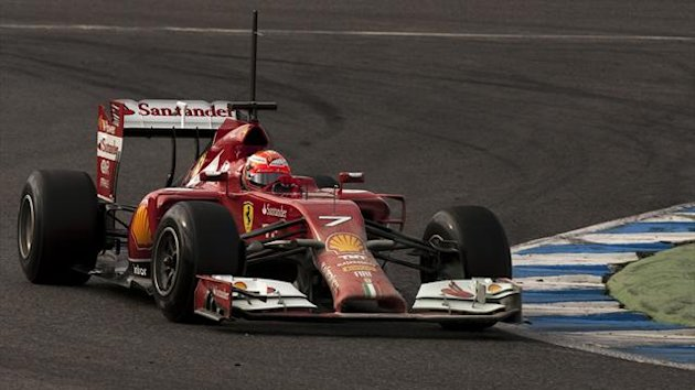 Ferrari Formula One racing driver Kimi Raikkonen of Finland drives the new F14 T during pre-season testing (AFP)