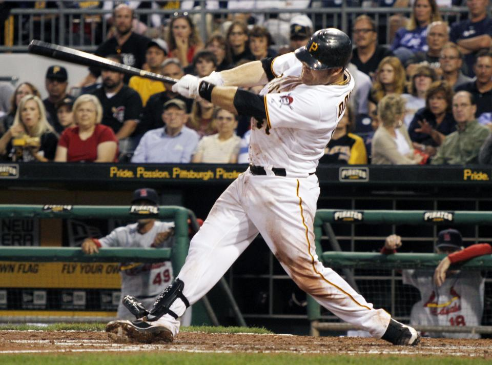 Pittsburgh Pirates' Ryan Doumit follows through for a three-run home run of off St. Louis Cardinals starting pitcher Jake Westbrook during the fourth inning of a baseball game on Monday, Aug. 15, 2011, in Pittsburgh. The Pirates won 6-2. (AP Photo/Keith Srakocic)