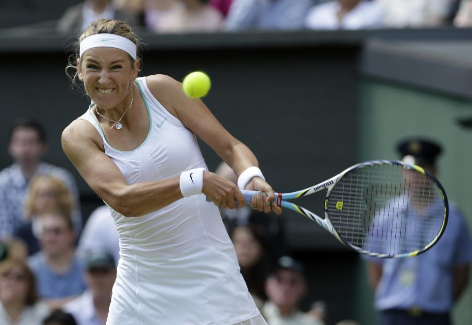 Victoria Azarenka of Belarus plays a shot to Serena Williams of the United States during a semifinals match at the All England Lawn Tennis Championships at Wimbledon, England, Thursday, July 5, 2012. (AP Photo/Anja Niedringhaus)