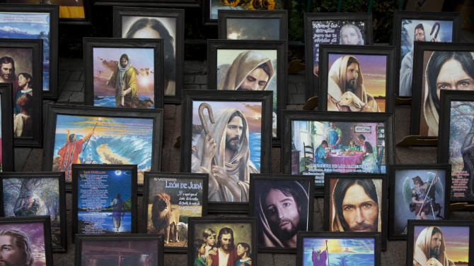 Pictures of Jesus are displayed for sale in the main plaza of Xochimilco, on the southern edge of Mexico City, Wednesday, May 7, 2014. In Xochimilco, busy markets stand side by side with colonial churches, and children ride to school in boats pushed by poles, along a network of canals and floating gardens that date to pre-hispanic times. The popular tourist destination was declared a UNESCO world heritage site in 1987. (AP Photo/Rebecca Blackwell)