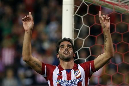 Atletico Madrid's Raul Garcia celebrates during a soccer match in Madrid November 6, 2013. REUTERS/Susana Vera/Files
