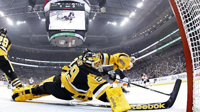 Philadelphia Flyers' Vincent Lecavalier (40) gets a shot under the stick of Pittsburgh Penguins goalie Marc-Andre Fleury (29) for a goal in the first period of an NHL hockey game in Pittsburgh Wednesday, April 1, 2015. The Flyers won 4-1. (AP Photo/Gene J. Puskar)