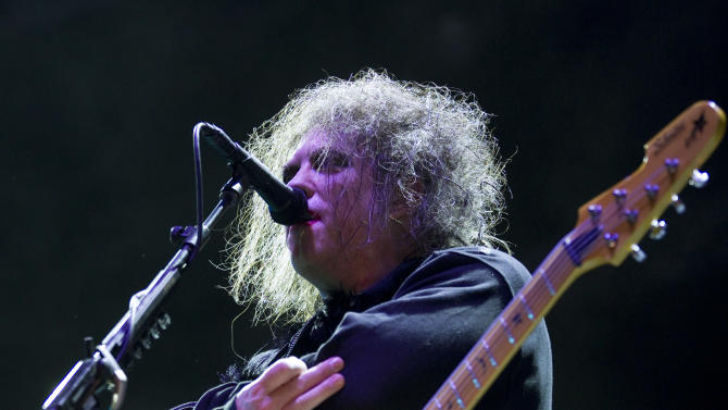FILE - In this July 14, 2012 file photo, Robert Smith, frontman of English rock band The Cure, performs during their concert at the Optimus Alive music festival in Lisbon, Portugal. The Cure will headline the Lollapalooza music festival in Chicago's Grant Park in August 2013 for the first time in the festival's more than 20-year history. (AP Photo/Armando Franca, File)  EDITORIAL USE ONLY